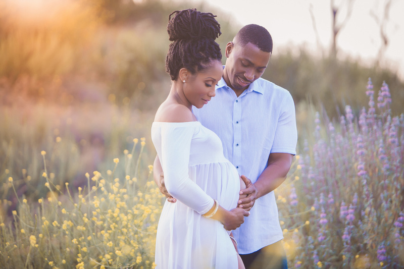 Maternity portraits in a field in San Diego.